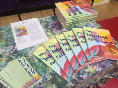 Copies of The Interfaith Family Journal on a table.